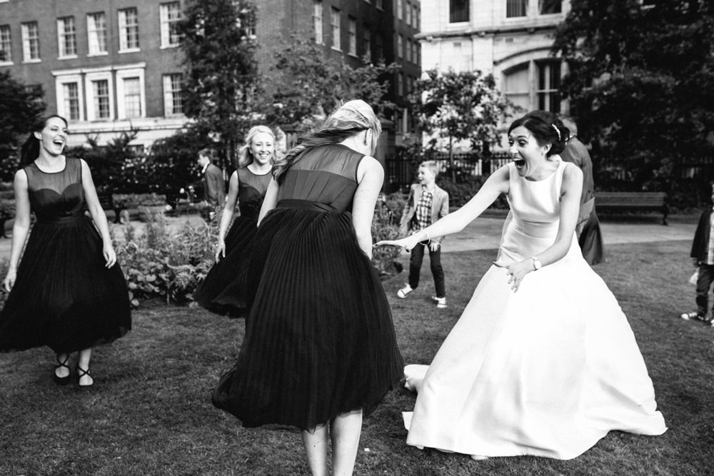 bridemaid and bride larking about and outside the venue.