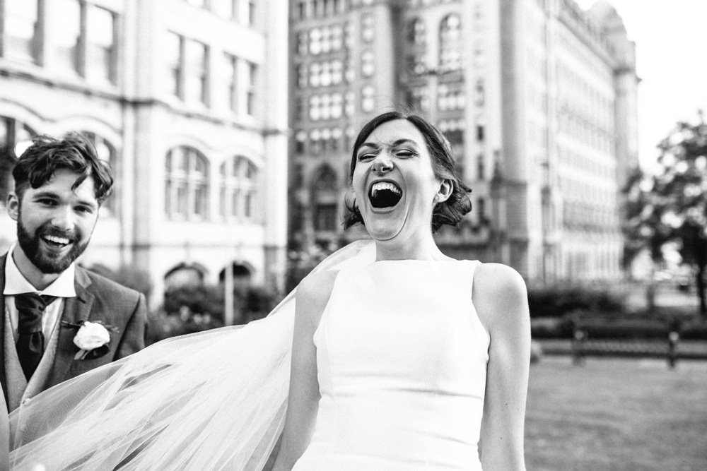 Bride roaring with laughter.