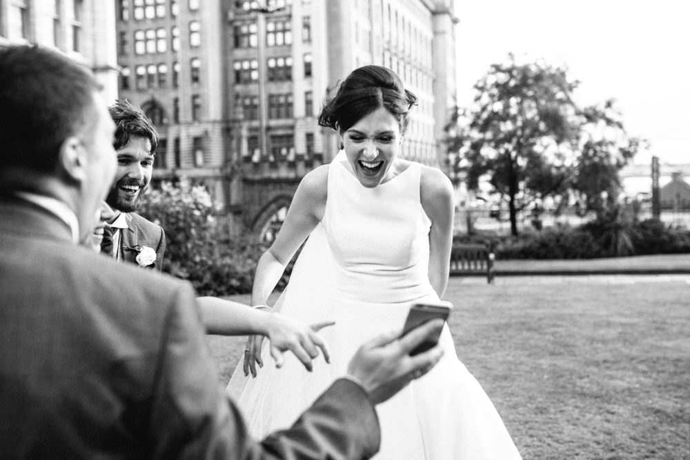 Bride and the party laughing at selfies