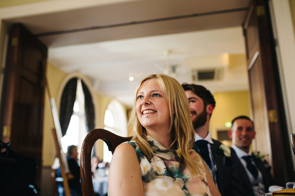 Speeches - guests look on smiling.
