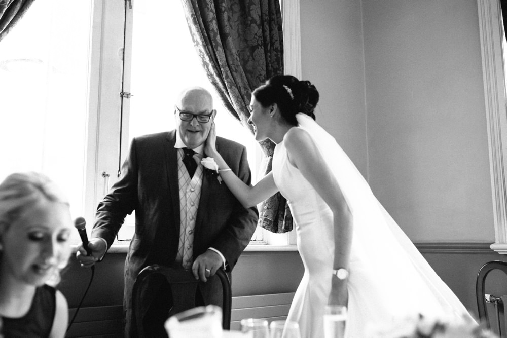 Speeches - bride and her dad share a moment.