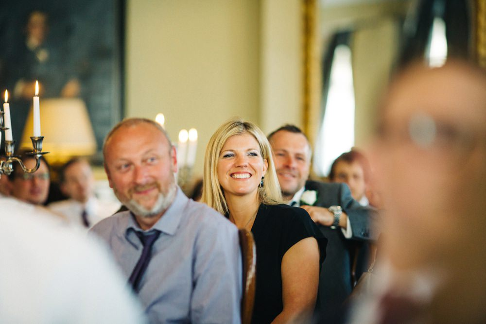 Guests smiling and laughing.