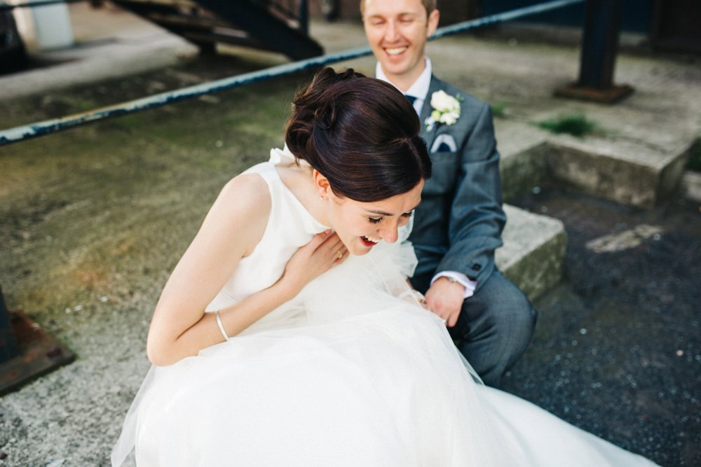 Bride really trying to catch her breath from laughing