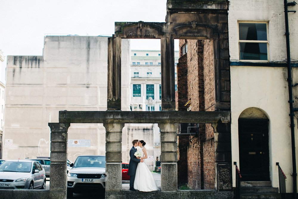 Couple in the arch doorway of a building that no longer exists.