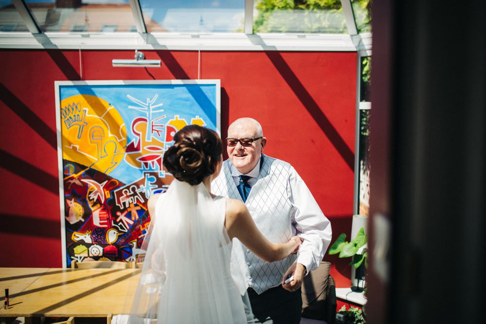 Dad see bride for first time in her dress.