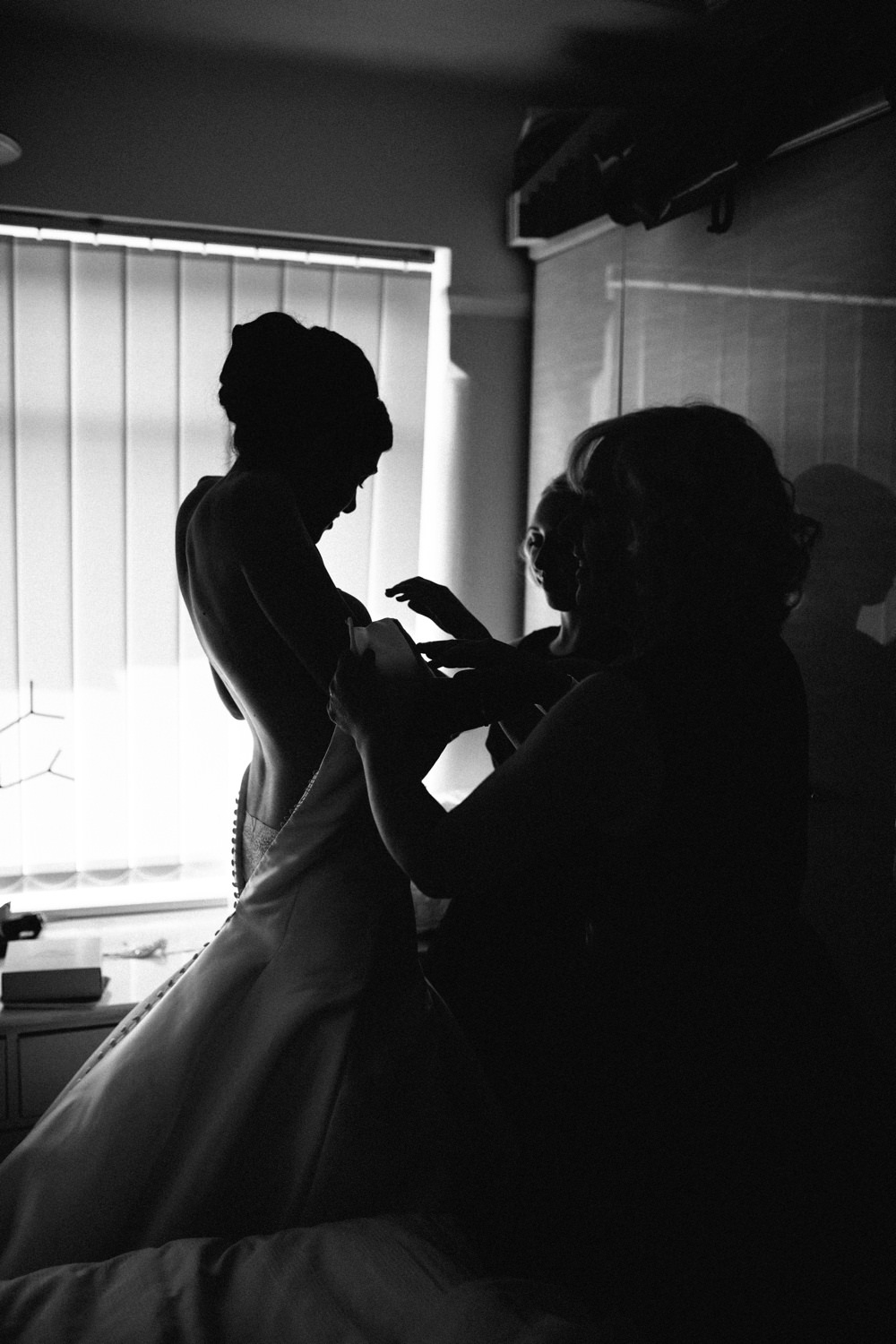 Bride stepping into dress.