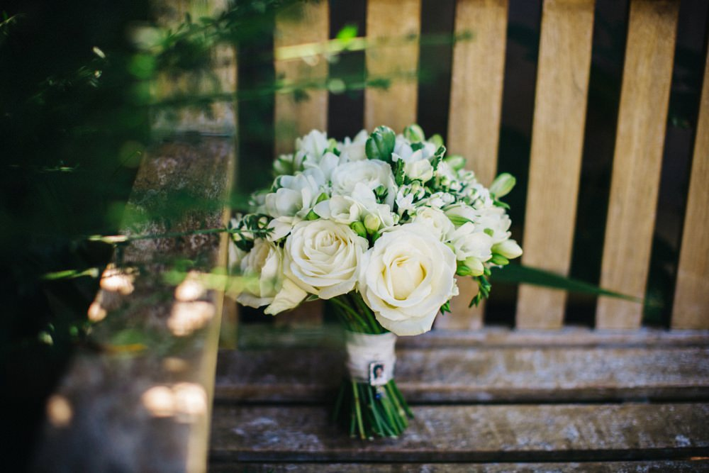 Bouquet on garden bench.