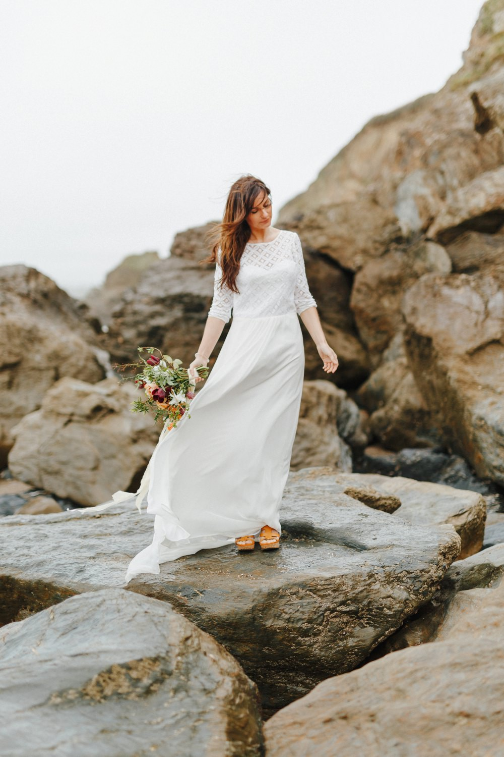 bride stood on rocks