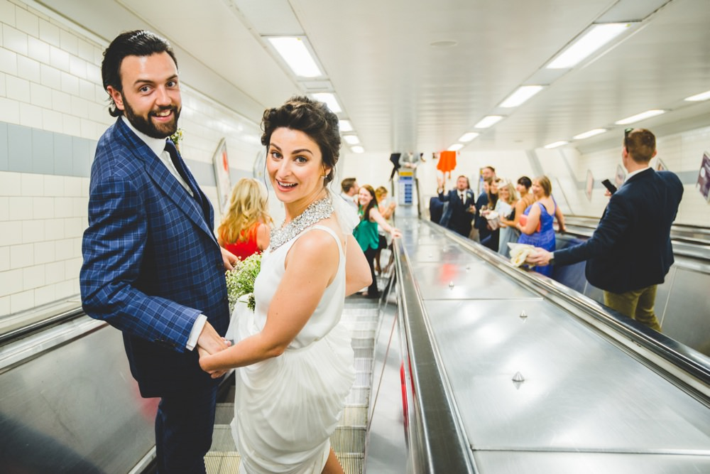 couple catching train with guests to venue