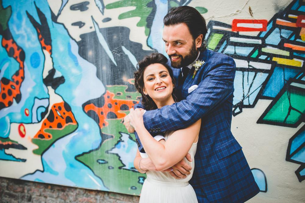 couple against grafitti wall