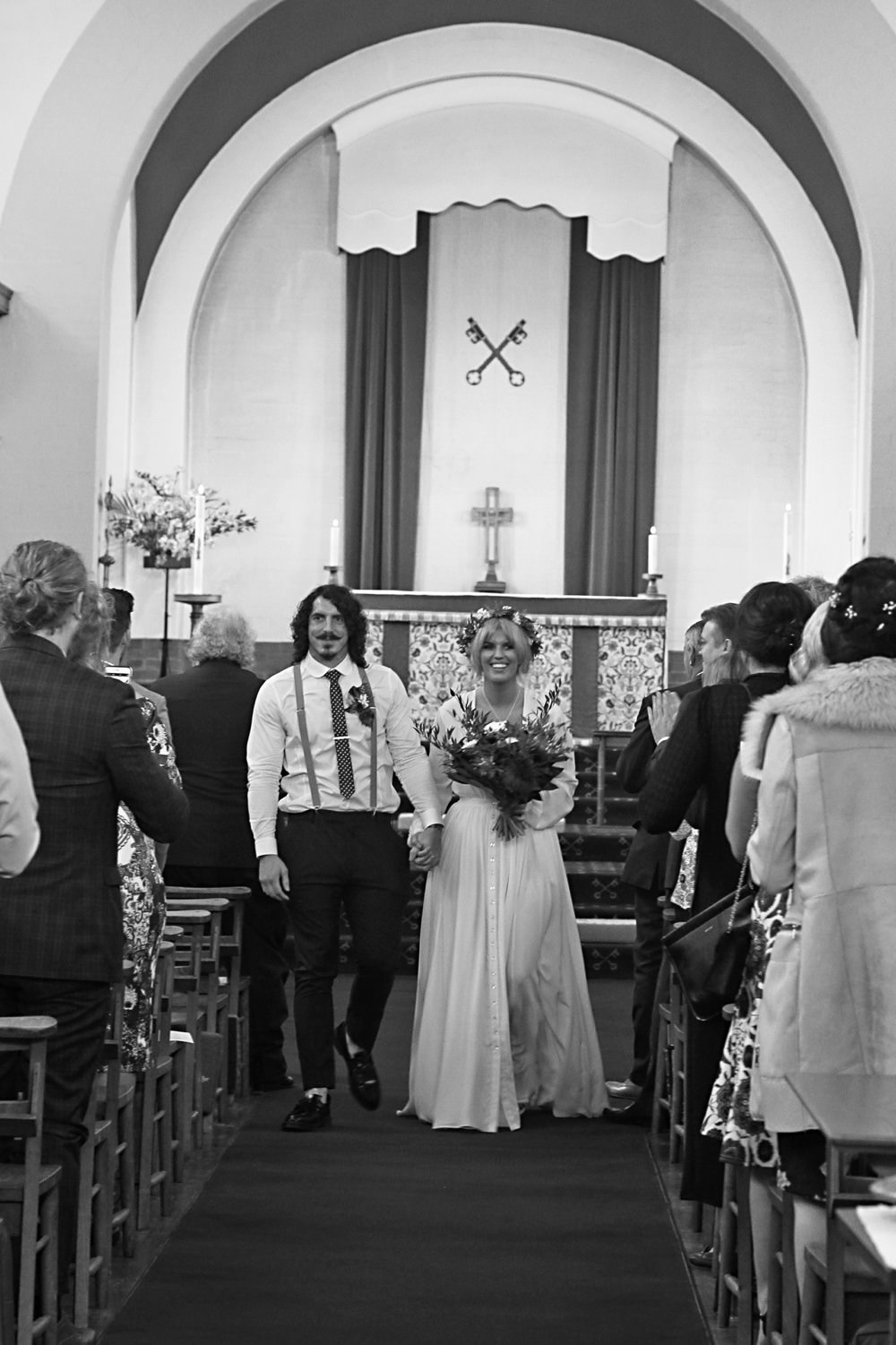 groom and bride laughing during ceremony
