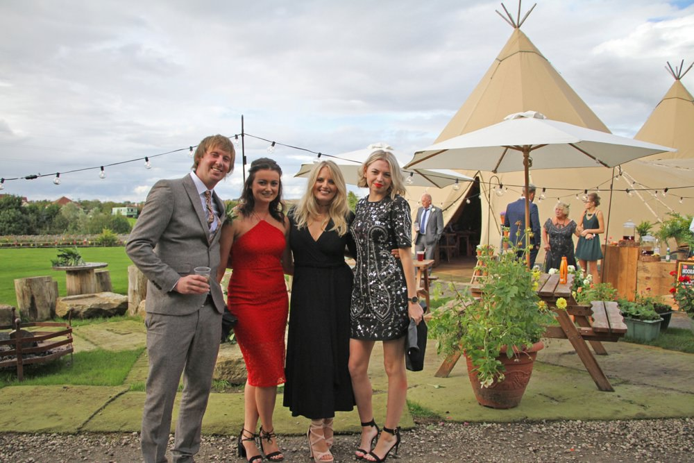 the bridesmaids at the tipis