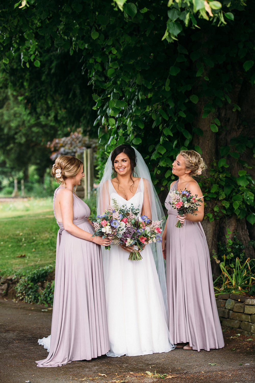 bridesmaids outside church