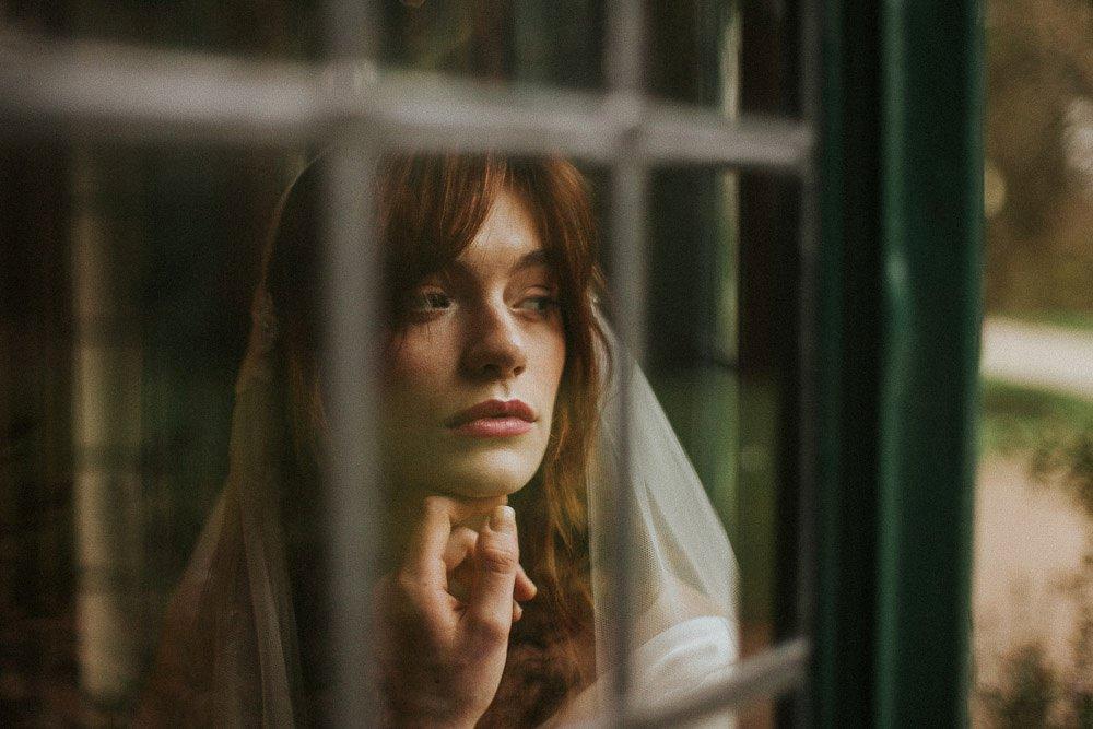 Didsbury Parsonage heritage bride looking through window
