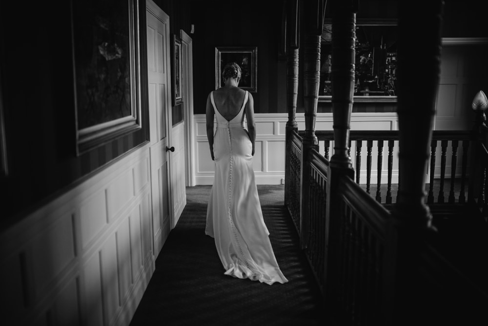 stunning dress ...the bride walks down the stairs to her father at her summer garden wedding