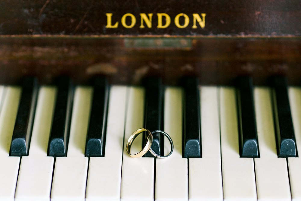 the wedding rings sat on the piano keyboard