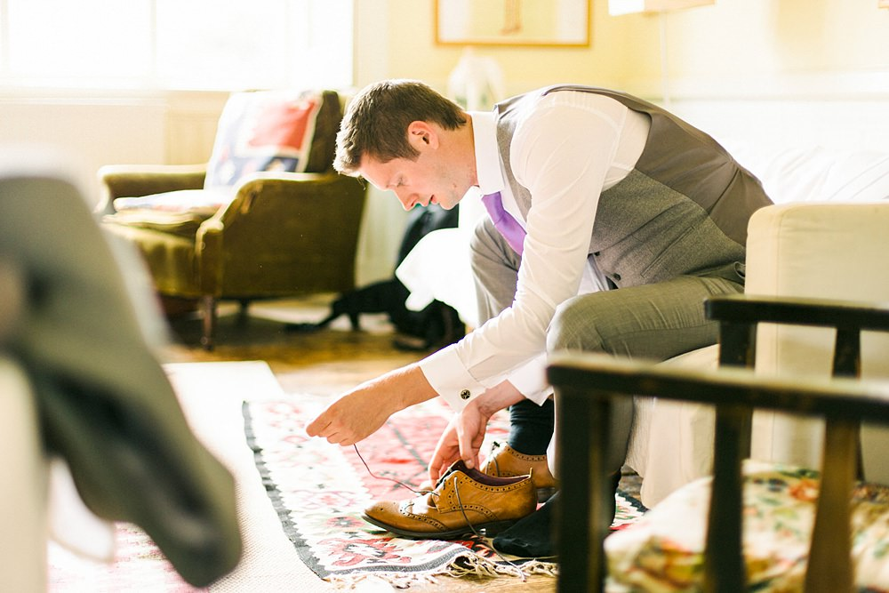 Groom doing his shoes